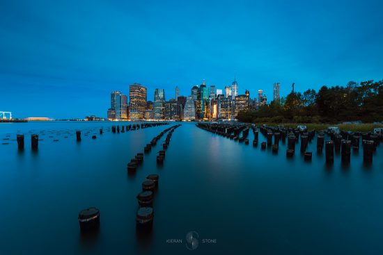 New York Manhattan from Brooklyn with pier