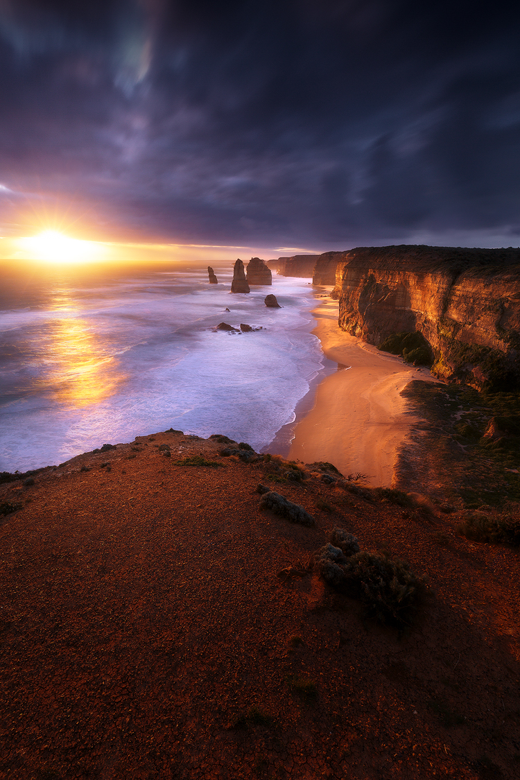 A fiery sunset at the iconic Australian coastline of the 12 Apostles