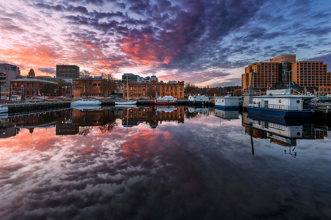 Calm, mirror finish water of Hobart's Harbour.