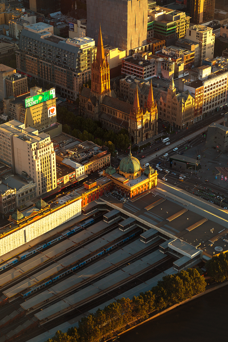 Golden morning light bathing the heart of Melbourne city