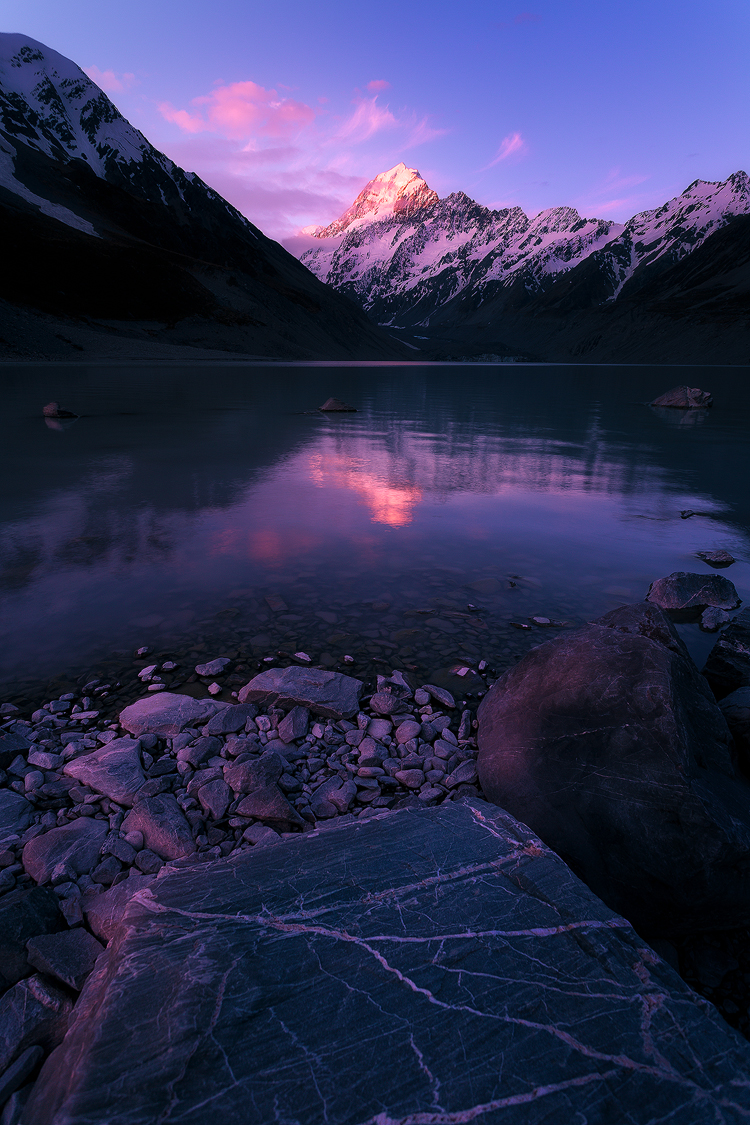 Mount Cook/Aoraki reflecting the last light in the waters of Hooker Lake