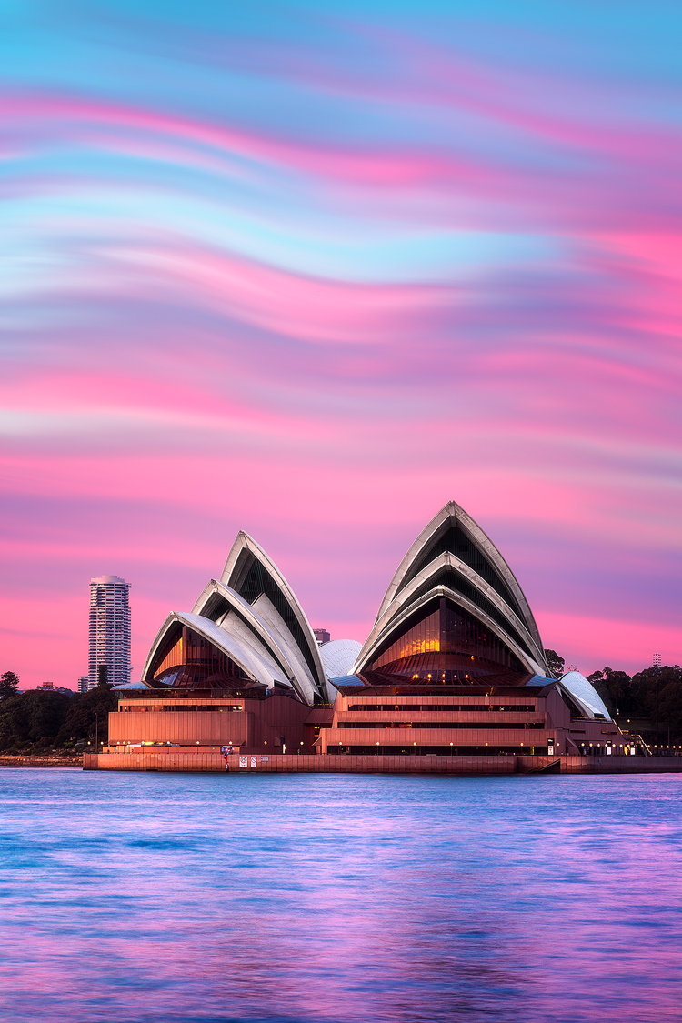 Sails of Sydney Opera House and pink waves in the sky