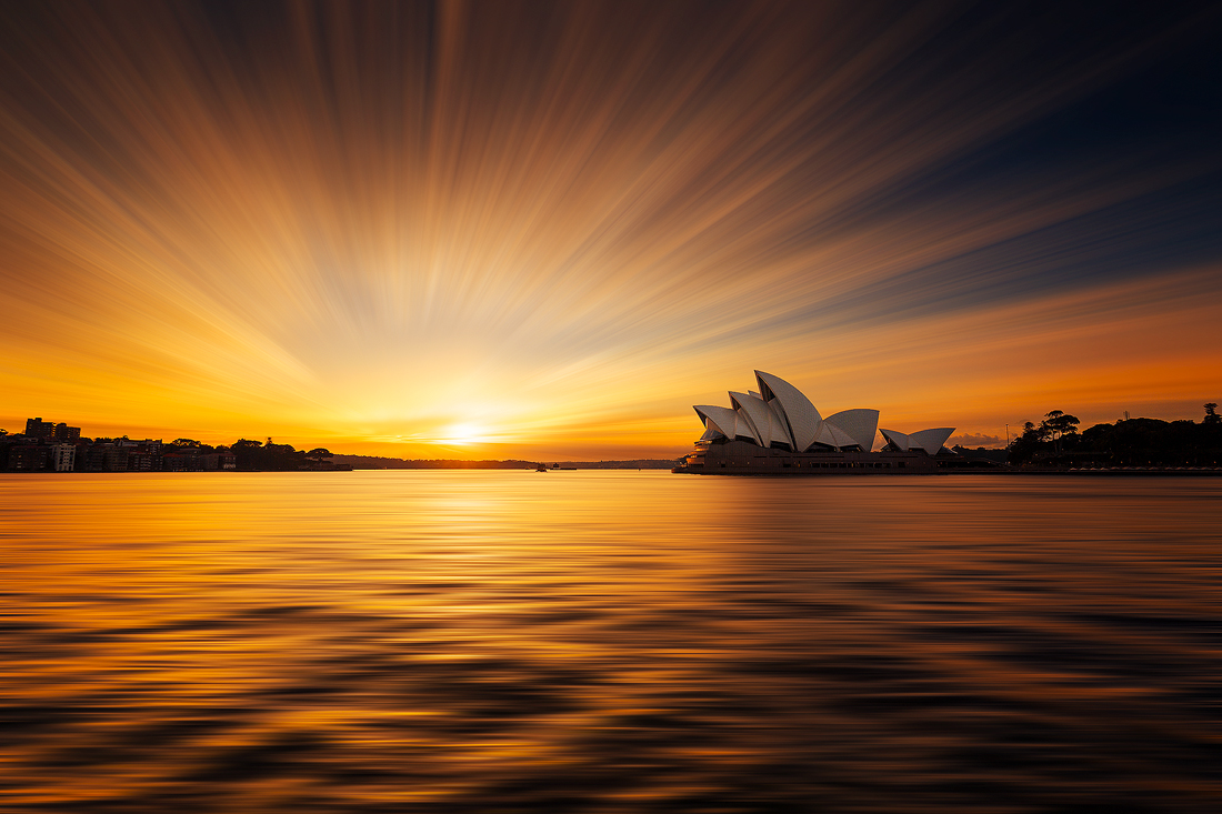 A golden sunrise over Sydney Harbour